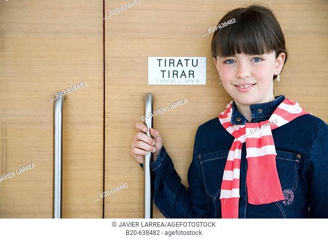 Girl by sign in Braille system at Kursaal Center. San Sebastian, Guipuzcoa, Euskadi, Spain