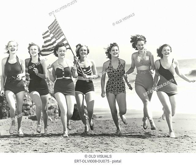 Patriotic women at the beach (OLVI008-OU075-F)