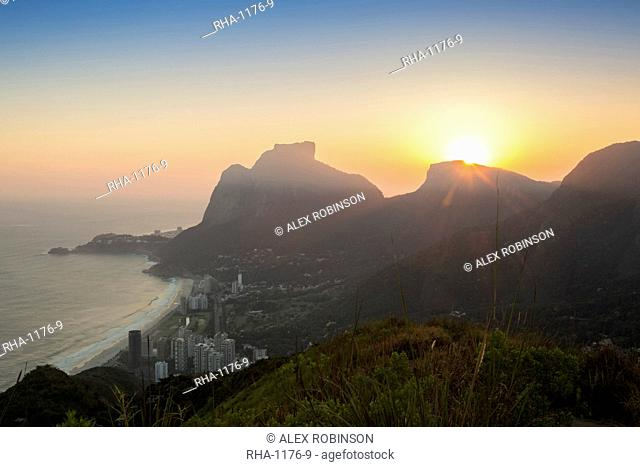 Sunset over Pedra da Gavea mountain (Gavea Rock), with the neighbourhood of Sao Conrado in foreground, Rio de Janeiro, Brazil, South America