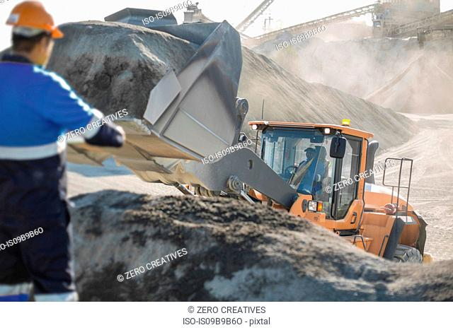Quarry worker using heavy machinery in quarry