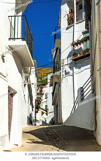 lane in the white village Trevélez, Andalusia, Spain