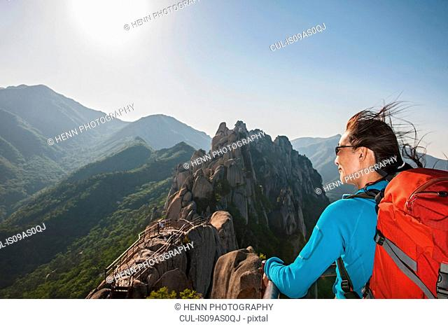 Hiker on top of Mt. Ulsanbawi at Seoraksan national park, Gangwon, South Korea