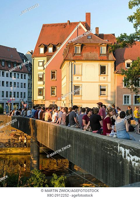 The Untere Bruecke (lower bridge) crossing the river Regnitz, a popular place for having a party. Bamberg in Franconia, a part of Bavaria