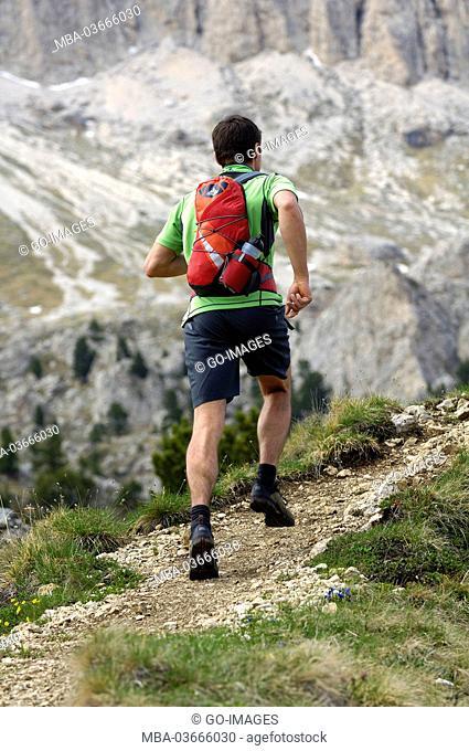 Man, mountain running, the Dolomites, South Tirol