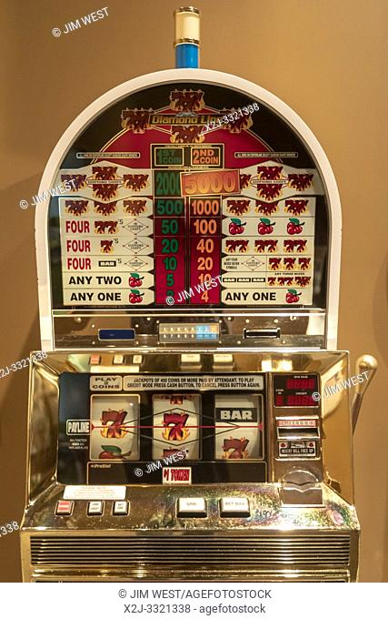 Mt. Pleasant, Michigan - A slot machine, part of an exhibit at the Ziibiwing Center of Anishinabe Culture & Lifeways, illustrates the Indians' connection to the...