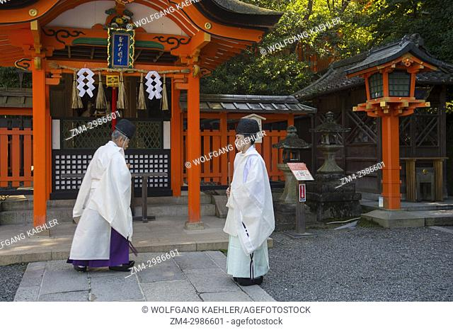 Shinto priests doing a ceremony in the morning at the Fushimi Inari Taisha shrine, a Shinto shrine in Kyoto, Japan