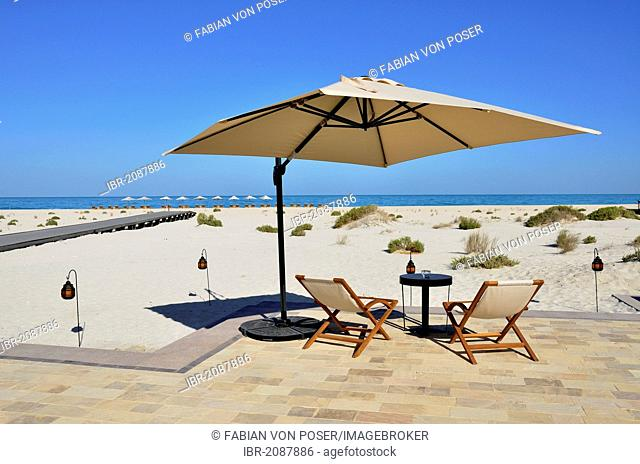 Deck chairs and sunshade, beach and outdoor area of the Park Hyatt hotel on Saadiyat Island, Abu Dhabi, United Arab Emirates, Arabian Peninsula, Asia