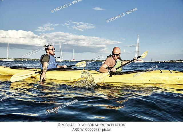 Photograph of two men in tandem sea kayak, Portland, Maine, USA