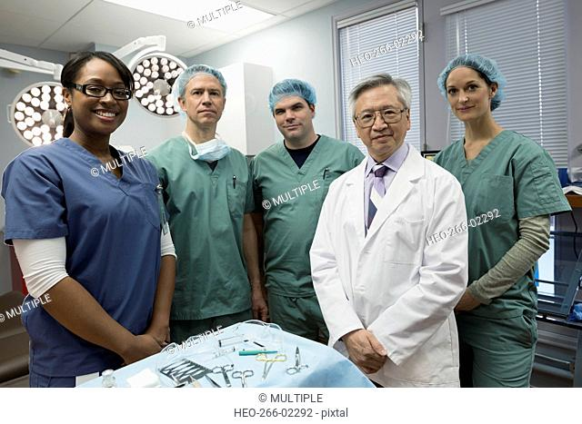 Portrait confident medical team in operating room