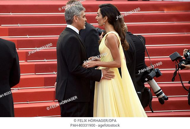 US actor George Clooney and his wife Amal arrive for the screening of 'Money Monster' during the 69th Annual Cannes Film Festival at Palais des Festivals in...
