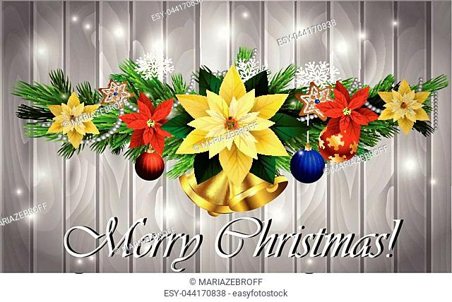 Christmas decoration with evergreen trees with balls gingerbread poinsettia golden bells on wood background