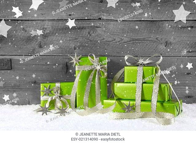 Green christmas background on grey wooden background with snow