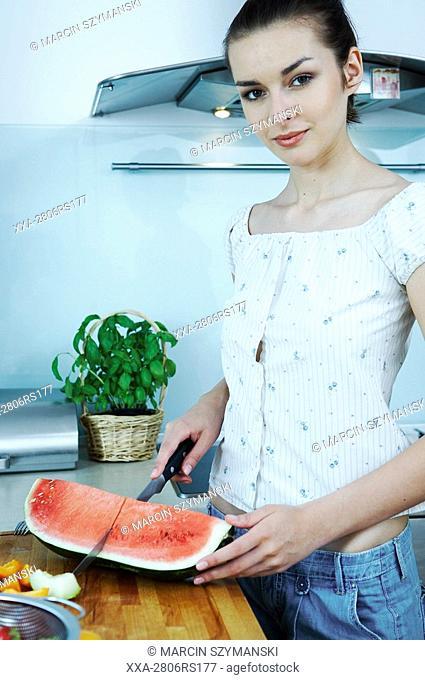 woman cutting watermelon