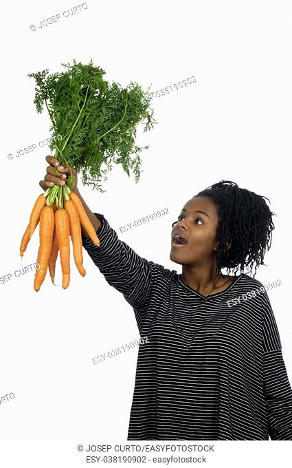 Teenage girl playing with a carrot,