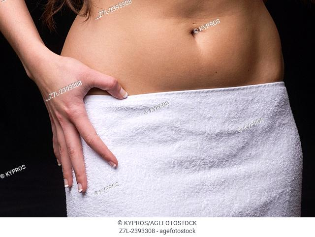 Young Woman Standing Wearing Bath Towel