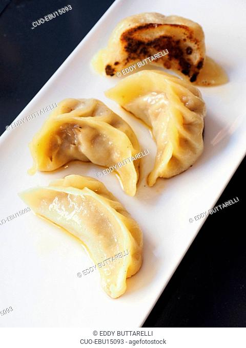 Cooked on the plate vegetables dumplings, Lombardy, Italy, Europe