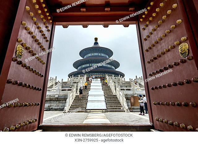 Beijing, China - Tourists walking to visit the Temple of Heaven, an imperial sacrificial altar located in Central Beijing