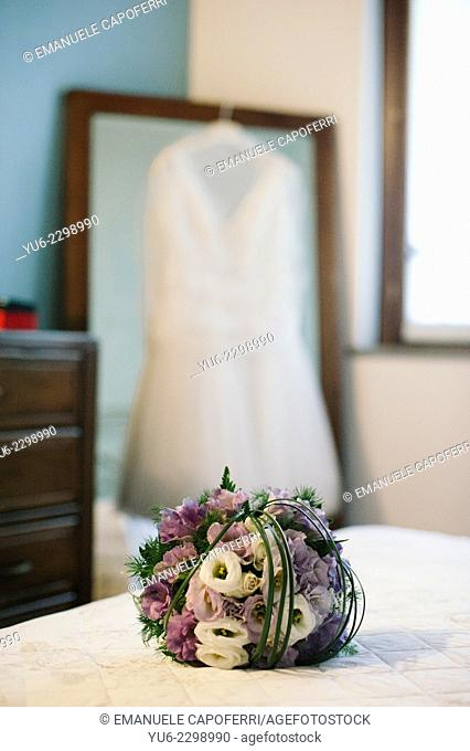 Bride's bouquet on the bed
