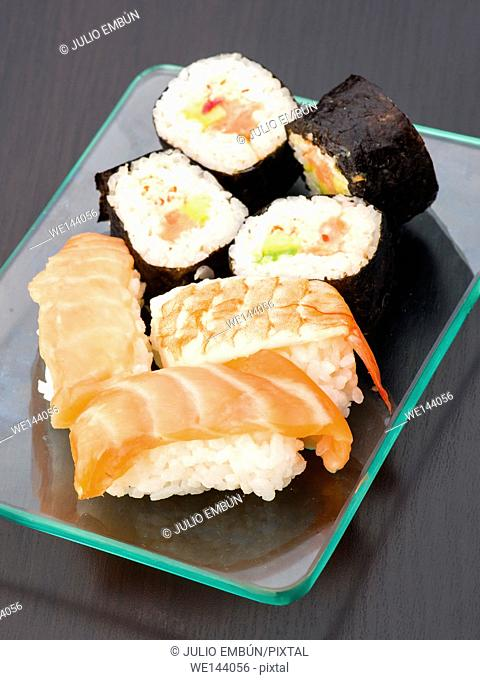 group of Japanese sushi on glass tray