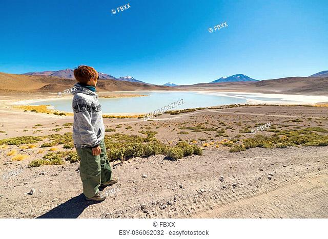 "Female tourist looking at the stunning landscape of """"Laguna Canapa"""", a salty lake on the way to the famous Uyuni Salt Flat"