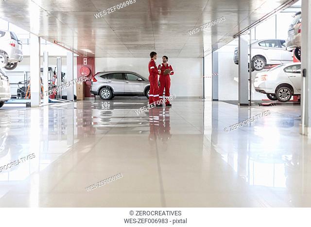 Car mechanics in repair garage