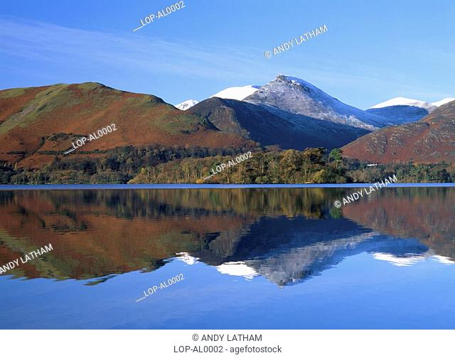 England, Cumbria, Derwent Water, Looking across Derwent Water on a calm day. Derwent Water is one of the principal bodies of water in the Lake District