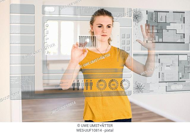 Young woman organizing virtual house model