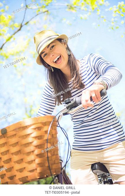 Portrait of mid adult woman riding bicycle