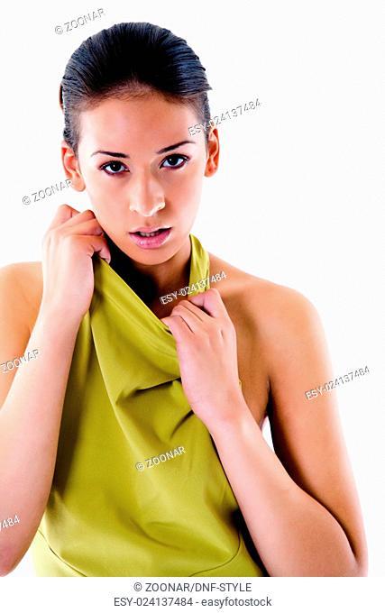 High fashion girl in green dress flirting