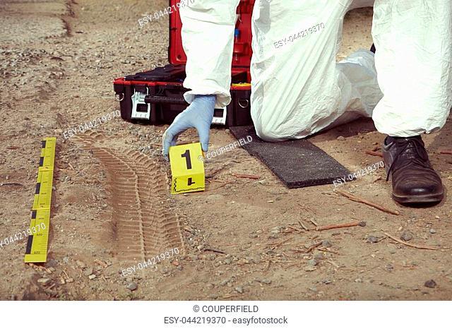 Crime scene investigation - exploring of car tire print left on crime scene