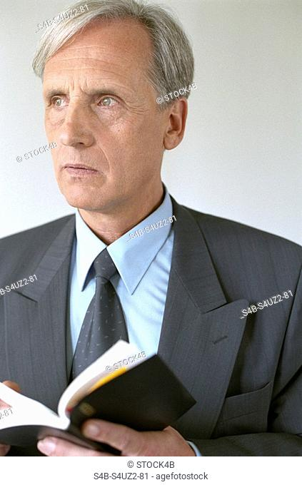 Reflective placement officer holding a diary