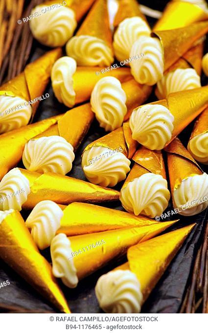 White chocolates at La Boqueria market, Barcelona. Catalonia, Spain