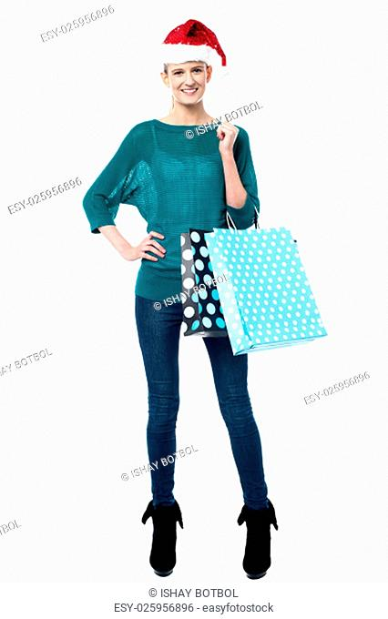 Full length shot of woman with shopping bags