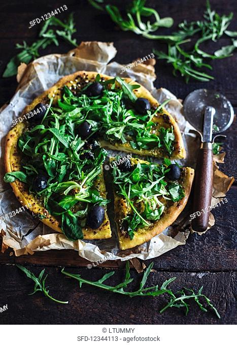 Vegetarian pizza with rocket and pesto sauce