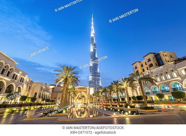 View of Burj Khalifa and Souq al Bahar at night in Downtown Dubai in United Arab Emirates