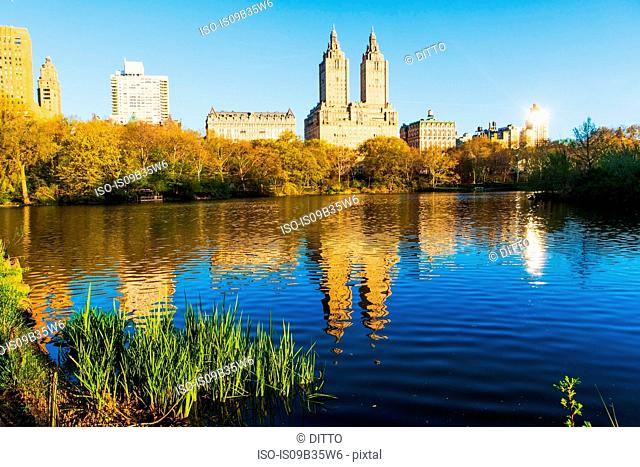 View of lake and skyscrapers from Central Park, New York, USA