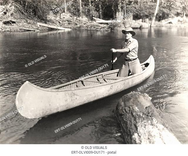 Man canoeing down river