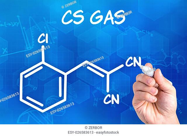 hand with pen drawing the chemical formula of CS Ga