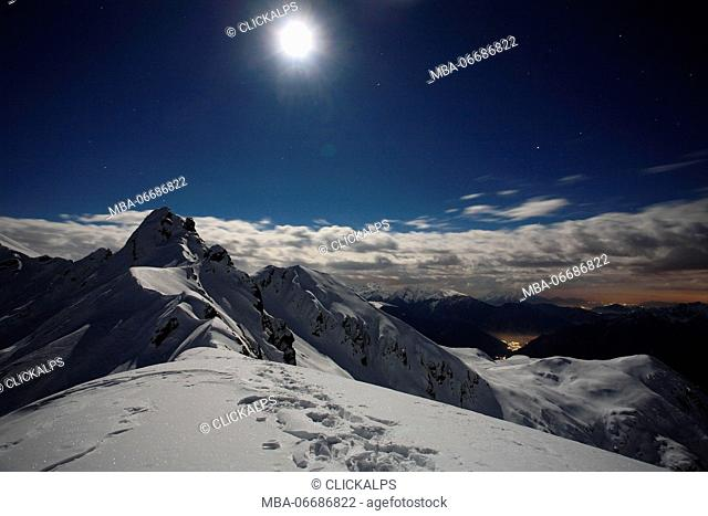 Full moon at Salmurano mountain on the Orobie alps, Lombardy, italy