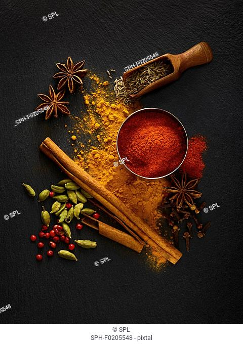 Dried spices on black slate