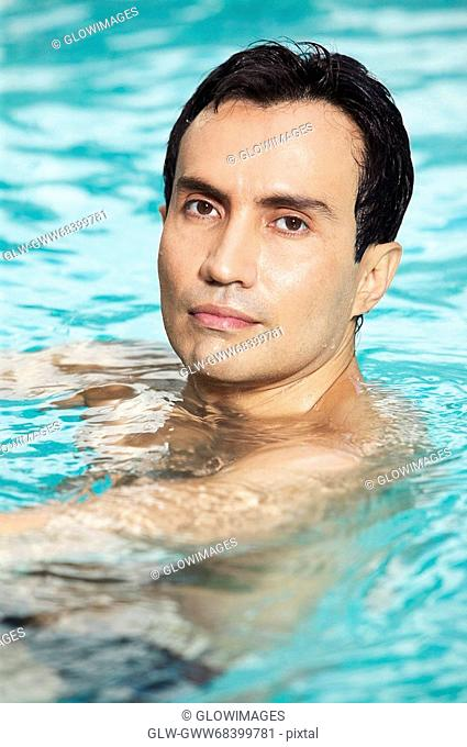 Portrait of a mature man swimming in a swimming pool