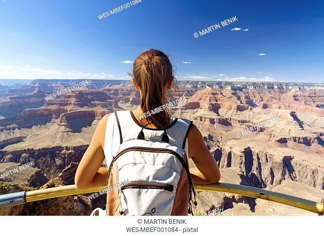 USA, Arizona, young woman enjoying the view at Grand Canyon, back view
