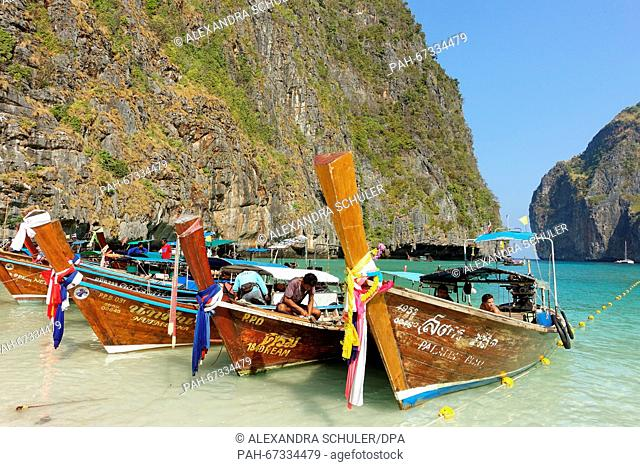 A Long-tail boats at Maya Bay on the island of Ko Phi Phi Don, Thailand, 10 March 2016. The bay was a shooting location for the movie 'The Beach' and has become...