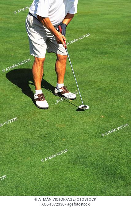 Senior man playing golf, South Tenerife, Canary Islands, Spain