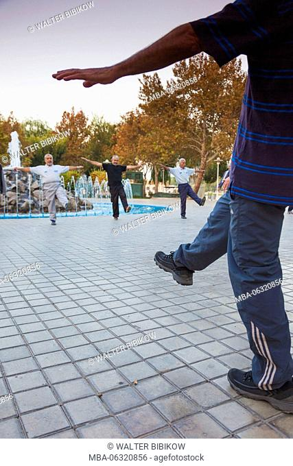 Iran, Central Iran, Esfahan, older men excercising by the river