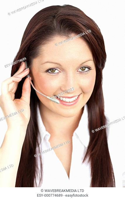 Merry young businesswoman wearing headphones against a white background