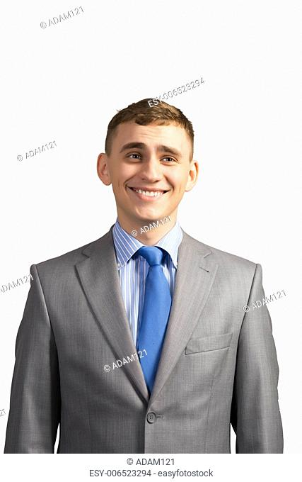 Portrait of a young businessman smiling, on a gray background, isolated on white background