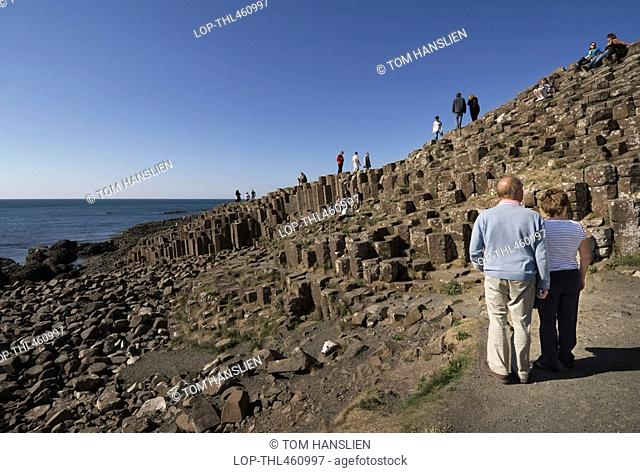 Northern Ireland, County Antrim, Giants Causeway, Tourists enjoying the wonder of the Giants Causeway, formed from 40,000 interlocking basalt columns