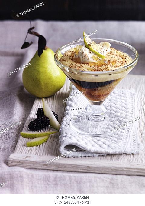 Trifle with pears, cream, blackberries and custard