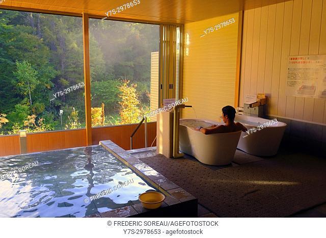Japanese man relaxing in bath, Takayama, Japan, Asia